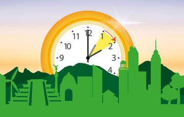 Reloj que señla que hay que adelantar una hora el reloj. en primer plano, edificois represetantivos de México