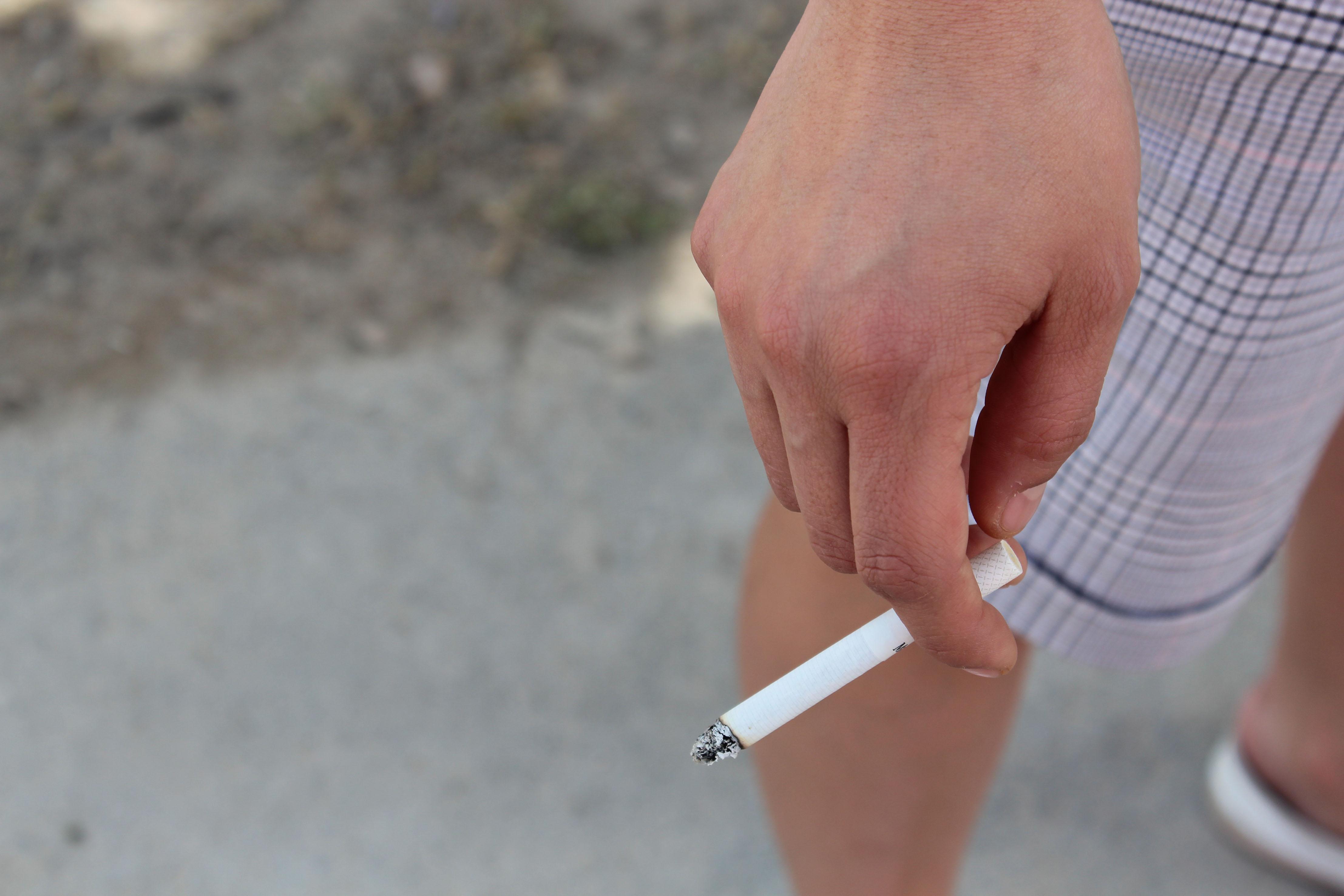 Consuming tobacco.