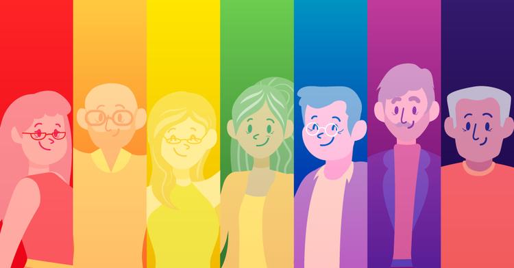Varias personas adultas mayores con la bandera arcoíris.