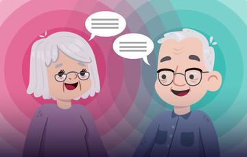 Dos personas mayores sonriendo.