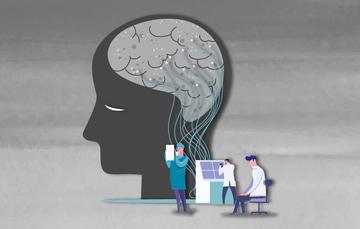 Tres personas estudiando un cerebro.