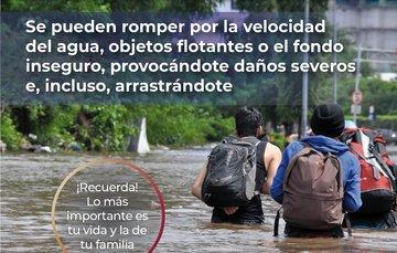 NUNCA intentes cruzar calles inundadas e inclinadas, puedes perder el control