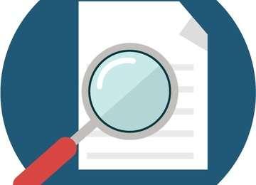 imagen de una hoja de papel siendo inspeccionada por una lupa