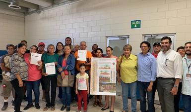 fotografía de los integrantes de un comité comunitario del Programa de Mejoramiento Urbano.
